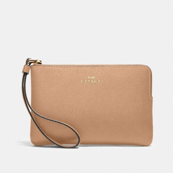 Coach Corner zip Wristlet in taupe leather